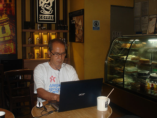 68-yr-old geek banging away in a coffee shop.